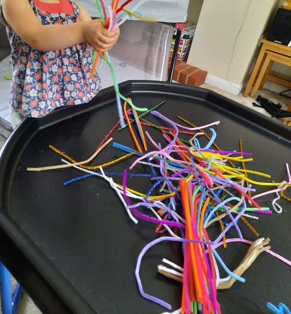 Pipe cleaners on a Tuff Tray.